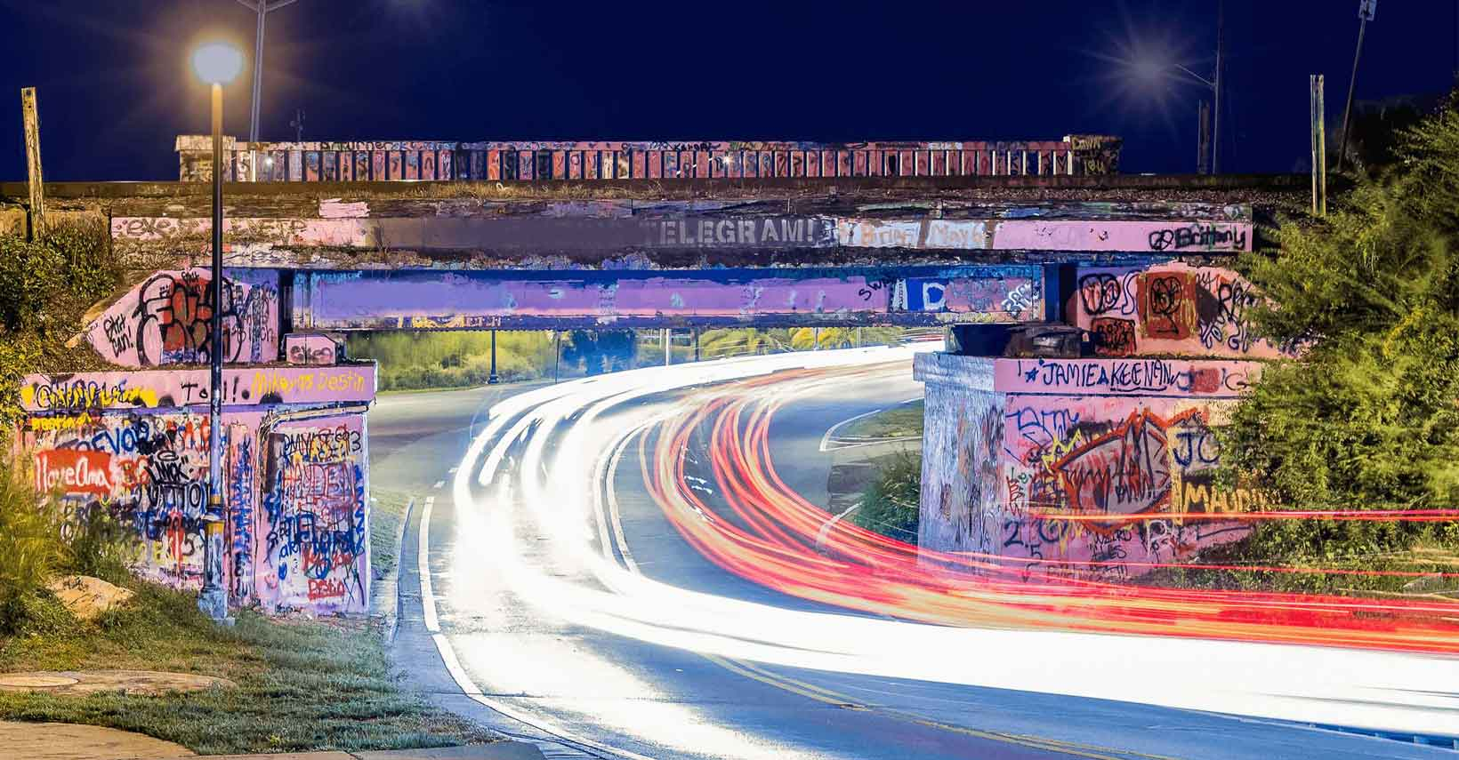 Traffic flowing through the famous Graffiti Bridge in Pensacola, Florida